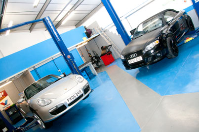 garage with Porche and Audi
